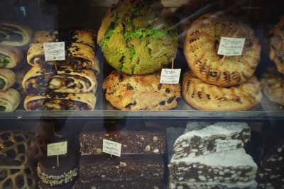 Assorted cakes and pastries in a shop window in Assisi